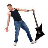 Holding guitar on foot Royalty Free Stock Images