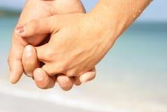 Holding-Hände Stockbild
