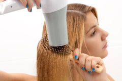 Holding hair dryer Stock Photo