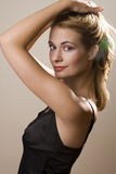 Holding hair up. Attractive blond girl holding her hair up and looking to the left Stock Image