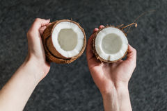 Holding half of a coconut Stock Images