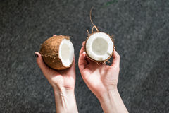 Holding half of a coconut Royalty Free Stock Photo