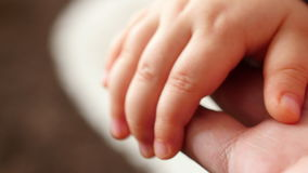 Holding hand of baby stock video footage