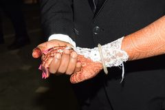 Holding Hand Ceremony Wedding occasion Shoot royalty free stock photo