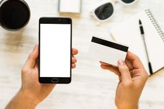 Holding hand credit card and using smartphone. A black smartphone mock up and a credit card in the hands. Of Closeup photo businessman Online payments plastic stock image