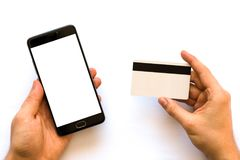 Holding hand credit card and using smartphone A black smartphone mock up and a credit card in the hands Closeup. Photo businessman. Online payments plastic card stock images