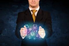 Holding hand drawn media icons Stock Image