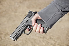 Holding a Hand Gun Royalty Free Stock Photos