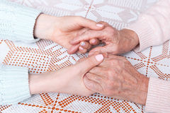 Holding hand. Home care elderly concept. stock images