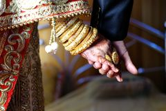 Holding hand indian married couple Stock Images