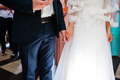Holding hand of newlywed. On church Royalty Free Stock Photo