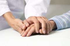 Holding hand Stock Image