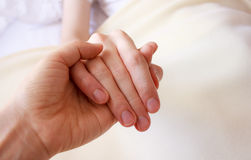 Holding the hand of a sick loved one Royalty Free Stock Image