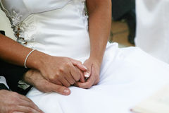 Holding hands. Bride and groom holding hands at wedding ceremony royalty free stock photo