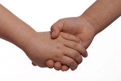 Holding Hands 2. Two sister holding hands on a white background Royalty Free Stock Image