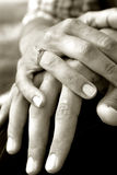 Holding Hands. Two hands holding together in monochrome royalty free stock photos