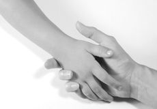 Holding Hands. Mother and child holding hands.  Black and white image on a white background Stock Image