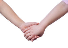 Holding Hands. Two young sisters holding hands. Isolated on white Stock Photo