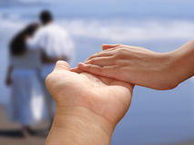 Holding Hands. Male and female holding hands Stock Photo