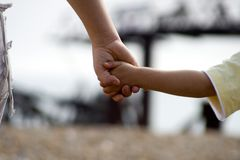 Holding Hands. Walking along Brighton Beach Holding hands Royalty Free Stock Photos