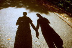 Holding hands. A couple holding each others hands while walking Royalty Free Stock Photo