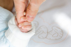 Holding hands of the baby and her father Stock Images