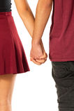 Holding Hands. Back view of young couple of sweethearts holding hands over white background stock photo