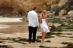 Holding Hands on Beach Royalty Free Stock Photos