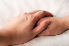 Holding hands in bed Royalty Free Stock Photography