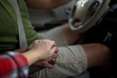 Holding hands in the car Stock Images