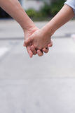 Holding hands and care. Couple holding hand while they are walking Stock Images