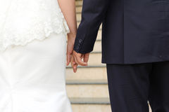 Holding Hands at Ceremony Royalty Free Stock Images