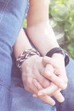 Holding hands, close-up Royalty Free Stock Photo