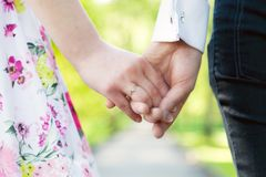 Holding hands close-up. Couple in love dating stock photo