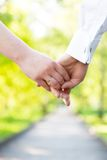 Holding hands close-up. Couple in love dating Royalty Free Stock Photos