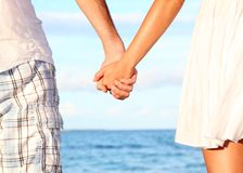 Holding hands couple stock photo