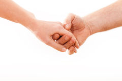Holding hands couple on white background. Royalty Free Stock Photography