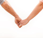 Holding hands couple on white background. Royalty Free Stock Images