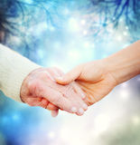 Holding hands with elderly woman Stock Image