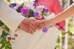 Holding hands with floral background Stock Photography
