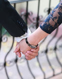 Holding Hands. Hands of elegant lovers. Lover hands together Stock Photos