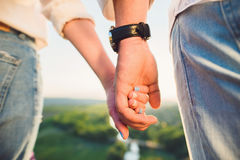 Holding Hands on Hill Stock Photos