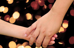 Holding hands and light blur Stock Photography
