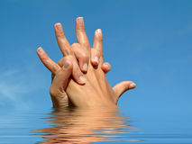 Holding hands in love reflected Royalty Free Stock Images