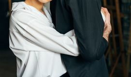 Holding hands. Lovers couple holding hands in a room. Hand in hand. hug stock photography