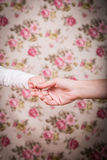 Holding hands Stock Photos