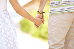 Holding hands in nature Royalty Free Stock Photography