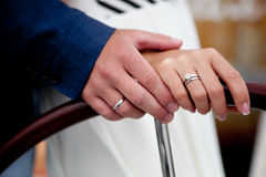 Holding hands newlyweds Stock Image