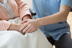 Holding hands with a nurse Stock Images