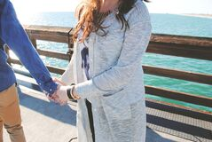 Holding Hands on Ocean Pier Royalty Free Stock Photography